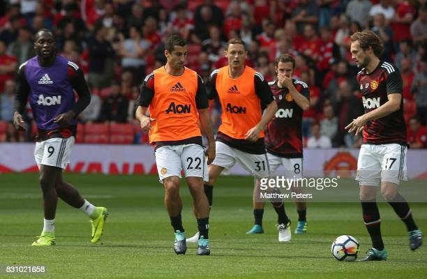 Henrikh Mkhitaryan and Daley Blind of Manchester United warm up ahead of the Premier League match between Manchester United and West Ham United at...