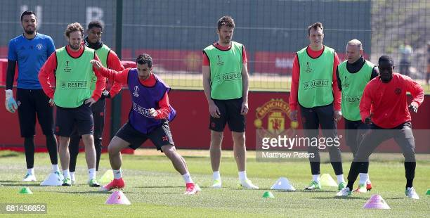 Henrikh Mkhitaryan and Eric Bailly of Manchester United in action during a first team training session at Aon Training Complex on May 10 2017 in...