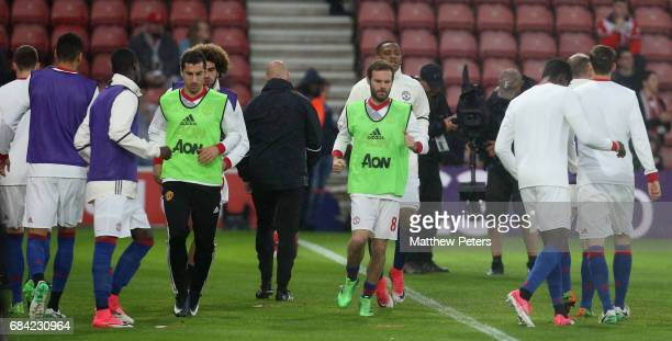 Henrikh Mkhitaryan and Juan Mata of Manchester United warm up ahead of the Premier League match between Southampton and Manchester United at St...