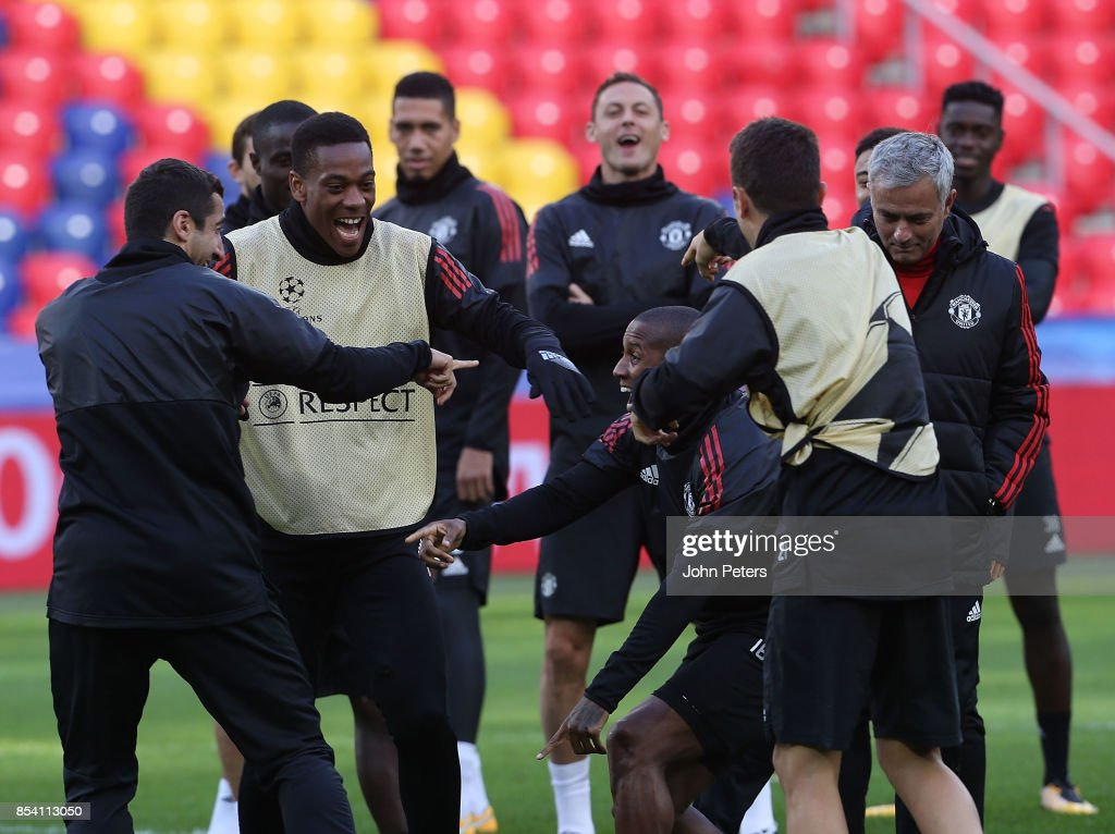 Henrikh Mkhitaryan, Anthony Martial and Ashley Young of Manchester United in action during a training session ahead of their UEFA Champions League match against CSKA Moscow at VEB Arena on September 26, 2017 in Moscow, Russia.