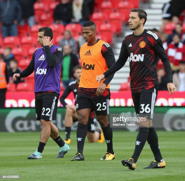 Henrikh Mkhitaryan Antonio Valencia and Matteo Darmian of Manchester United warm up ahead of the Premier League match between Stoke City and...