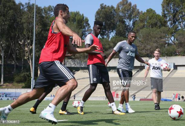 Henrikh Mkhitaryan Axel Tuanzebe and Antonio Valencia of Manchester United in action during a first team training session as part of their preseason...