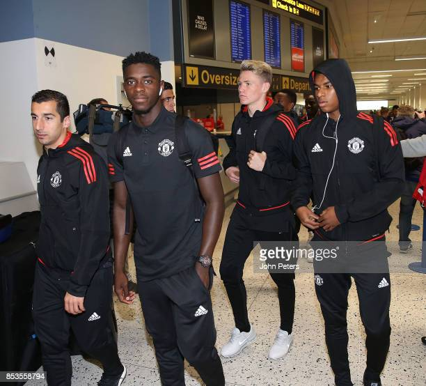 Henrikh Mkhitaryan Axel Tuanzebe Scott McTominay and Marcus Rashford of Manchester United check in ahead of the flight to Moscow for their Champions...