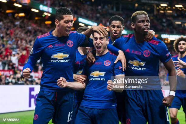 Henrikh Mkhitaryan Chris Smalling and Paul Pogba of Manchester United celebrate scoring the 02 goal during the UEFA Europa League final between Ajax...
