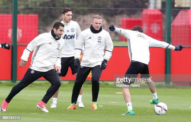 Henrikh Mkhitaryan Matteo Darmian Wayne Rooney and Juan Mata of Manchester United in action during a first team training session at Aon Training...