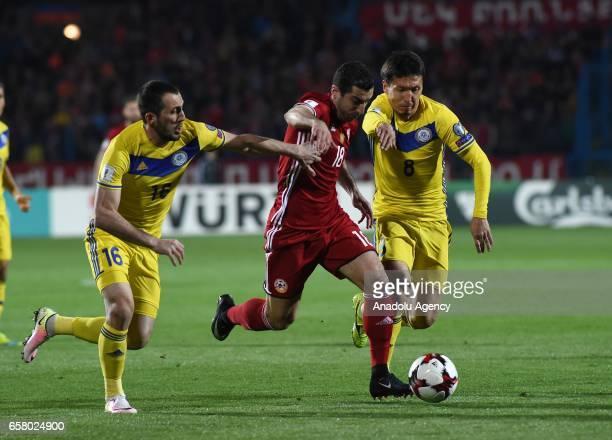 Henrikh Mkhitaryan of Armenia in action against Gafurzhan Suyumbayev and Ashkhat Tagybergen of Kazakhstan during the FIFA 2018 World Cup Qualifying...