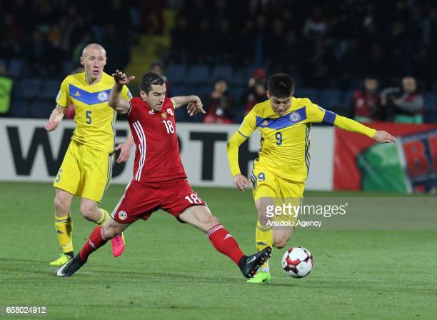 Henrikh Mkhitaryan of Armenia in action against Islambek Kuat and Bauyrzhan Islamkhan of Kazakhstan during the FIFA 2018 World Cup Qualifying Round...