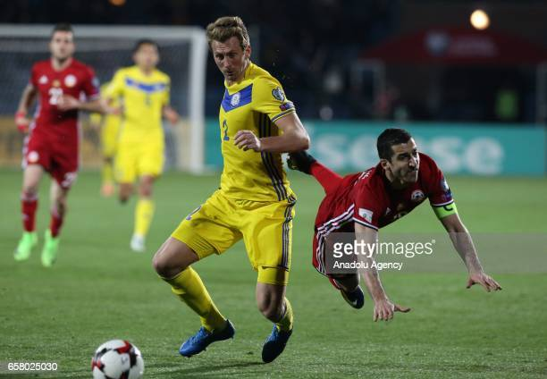 Henrikh Mkhitaryan of Armenia in action against Sergei Maliy of Kazakhstan during the FIFA 2018 World Cup Qualifying Round football match between...
