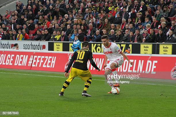 Henrikh Mkhitaryan of Borussia Dortmund and Jones Hector of 1 FC Koln vie for the ball during the Bundesliga soccer match between 1 FC Cologne and...