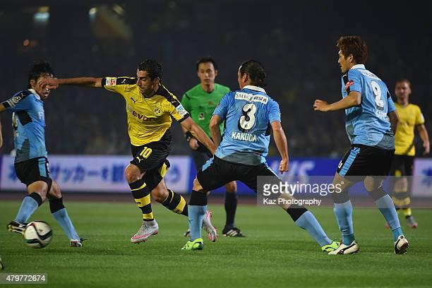 Henrikh Mkhitaryan of Borussia Dortmund beats the defense of Kawasaki Frontale during the preseason friendly match between Kawasaki Frontale and...