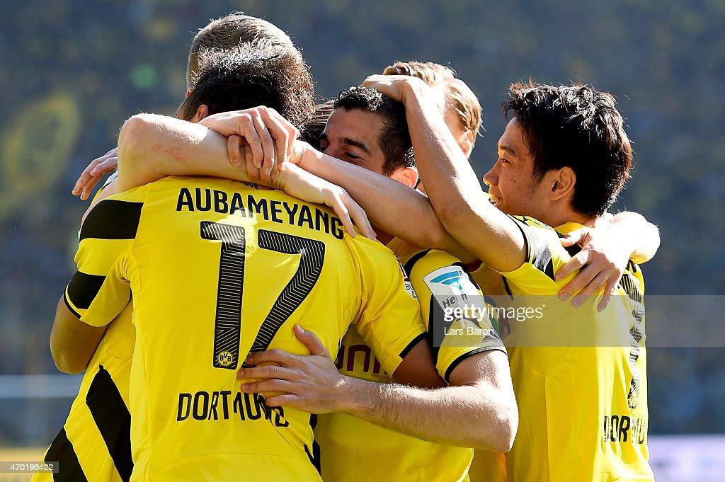 Henrikh Mkhitaryan of Borussia Dortmund celebrates after scoring his teams first goal during the Bundesliga match between Borussia Dortmund and SC...