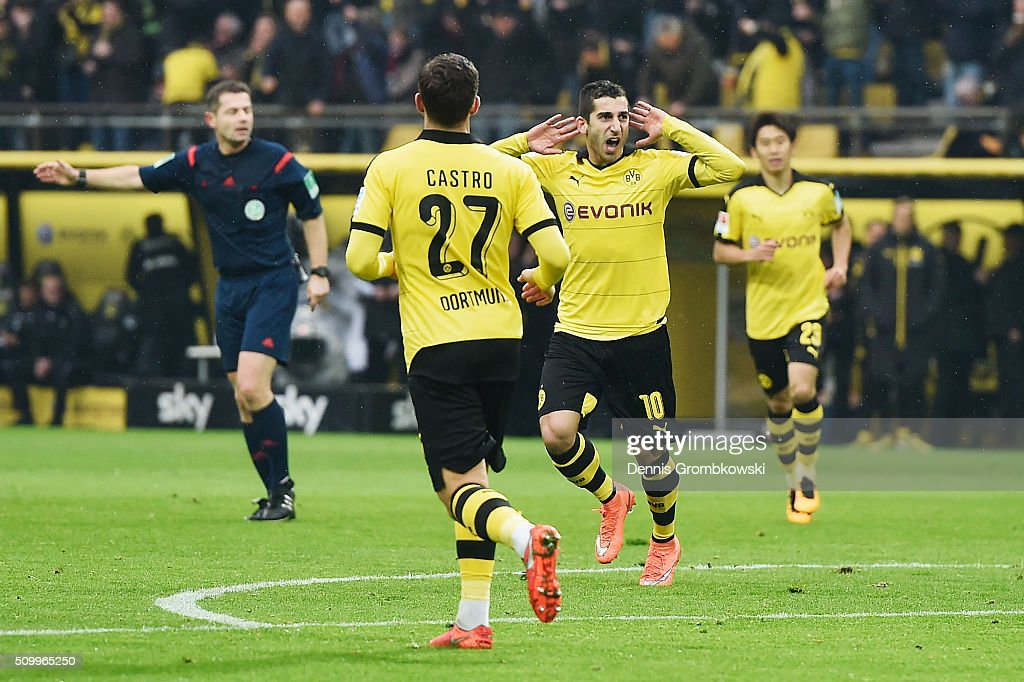 <a gi-track='captionPersonalityLinkClicked' href=/galleries/search?phrase=Henrikh+Mkhitaryan&family=editorial&specificpeople=6234732 ng-click='$event.stopPropagation()'>Henrikh Mkhitaryan</a> of Borussia Dortmund celebrates as he scores the opening goal during the Bundesliga match between Borussia Dortmund and Hannover 96 at Signal Iduna Park on February 13, 2016 in Dortmund, Germany.