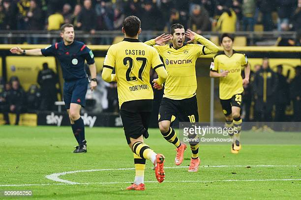 Henrikh Mkhitaryan of Borussia Dortmund celebrates as he scores the opening goal during the Bundesliga match between Borussia Dortmund and Hannover...