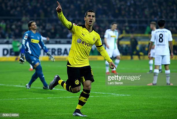 Henrikh Mkhitaryan of Borussia Dortmund celebrates as he scores their second goal during the Bundesliga match between Borussia Moenchengladbach and...