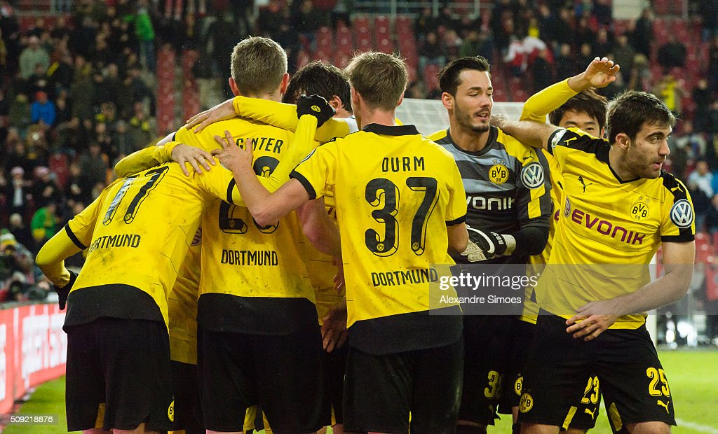 Henrikh Mkhitaryan of Borussia Dortmund celebrates scoring the winning goal together with his team mates during the DFB Cup match between VfB Stuttgart and Borussia Dortmund at Mercedes-Benz Arena on February 09, 2016 in Stuttgart, Germany.