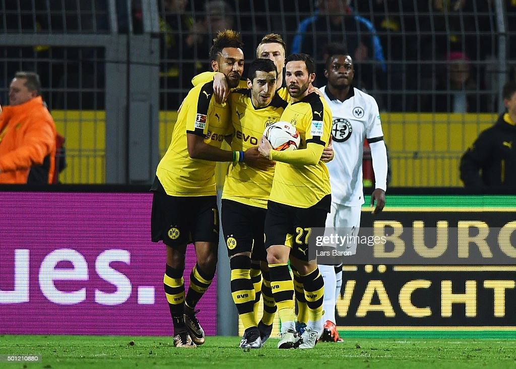 <a gi-track='captionPersonalityLinkClicked' href=/galleries/search?phrase=Henrikh+Mkhitaryan&family=editorial&specificpeople=6234732 ng-click='$event.stopPropagation()'>Henrikh Mkhitaryan</a> of Borussia Dortmund (C) celebrates with Pierre-Emerick Aubameyang (L) and <a gi-track='captionPersonalityLinkClicked' href=/galleries/search?phrase=Gonzalo+Castro&family=editorial&specificpeople=605388 ng-click='$event.stopPropagation()'>Gonzalo Castro</a> (R) as he scores their first and equalising goal during the Bundesliga match between Borussia Dortmund and Eintracht Frankfurt at Signal Iduna Park on December 13, 2015 in Dortmund, Germany.
