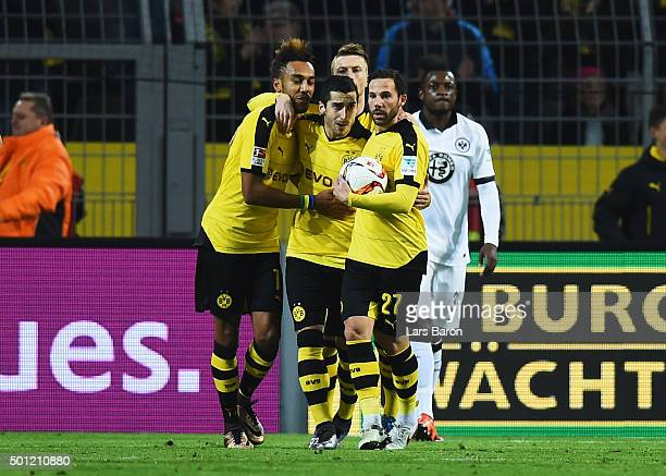 Henrikh Mkhitaryan of Borussia Dortmund celebrates with PierreEmerick Aubameyang and Gonzalo Castro as he scores their first and equalising goal...