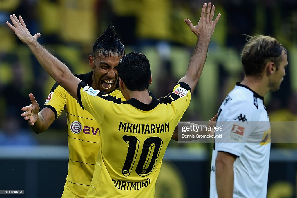 <a gi-track='captionPersonalityLinkClicked' href=/galleries/search?phrase=Henrikh+Mkhitaryan&family=editorial&specificpeople=6234732 ng-click='$event.stopPropagation()'>Henrikh Mkhitaryan</a> of Borussia Dortmund celebrates with team mate Pierre-Emerick Aubameyang as he scores the fourth goal during the Bundesliga match between Borussia Dortmund and Borussia Moenchengladbach at Signal Iduna Park on August 15, 2015 in Dortmund, Germany.