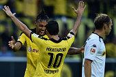 Henrikh Mkhitaryan of Borussia Dortmund celebrates with team mate PierreEmerick Aubameyang as he scores the fourth goal during the Bundesliga match...