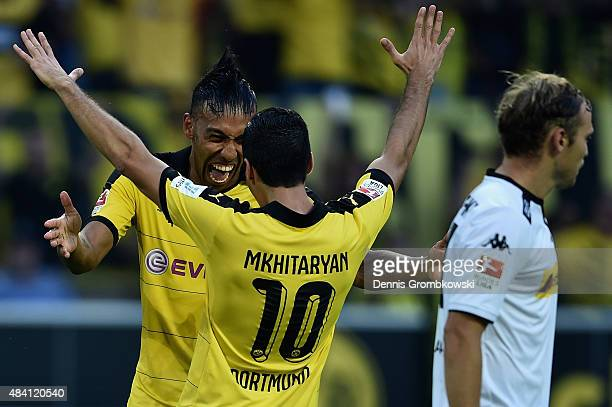 Henrikh Mkhitaryan of Borussia Dortmund celebrates with team mate PierreEmerick Aubameyang as he scores the fourth goal during the Bundesliga match...