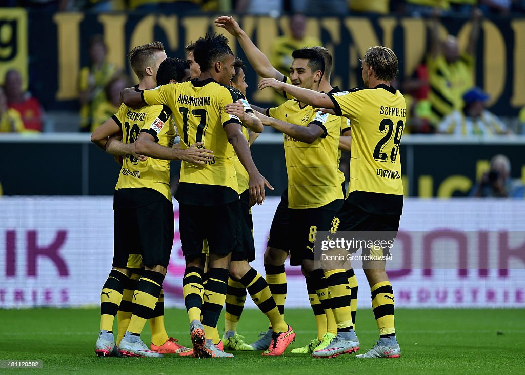 <a gi-track='captionPersonalityLinkClicked' href=/galleries/search?phrase=Henrikh+Mkhitaryan&family=editorial&specificpeople=6234732 ng-click='$event.stopPropagation()'>Henrikh Mkhitaryan</a> of Borussia Dortmund celebrates with team mates as he scores the fourth goal during the Bundesliga match between Borussia Dortmund and Borussia Moenchengladbach at Signal Iduna Park on August 15, 2015 in Dortmund, Germany.