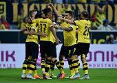 Henrikh Mkhitaryan of Borussia Dortmund celebrates with team mates as he scores the fourth goal during the Bundesliga match between Borussia Dortmund...