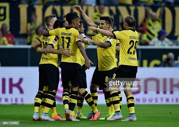 Henrikh Mkhitaryan of Borussia Dortmund celebrates with team mates as he scores the fourth goal during the Bundesliga match between Borussia Dortmund...