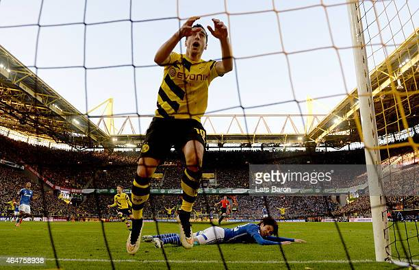 Henrikh Mkhitaryan of Borussia Dortmund celebrates with team mates after scoring his teams second goal during hte Bundesliga match between Borussia...