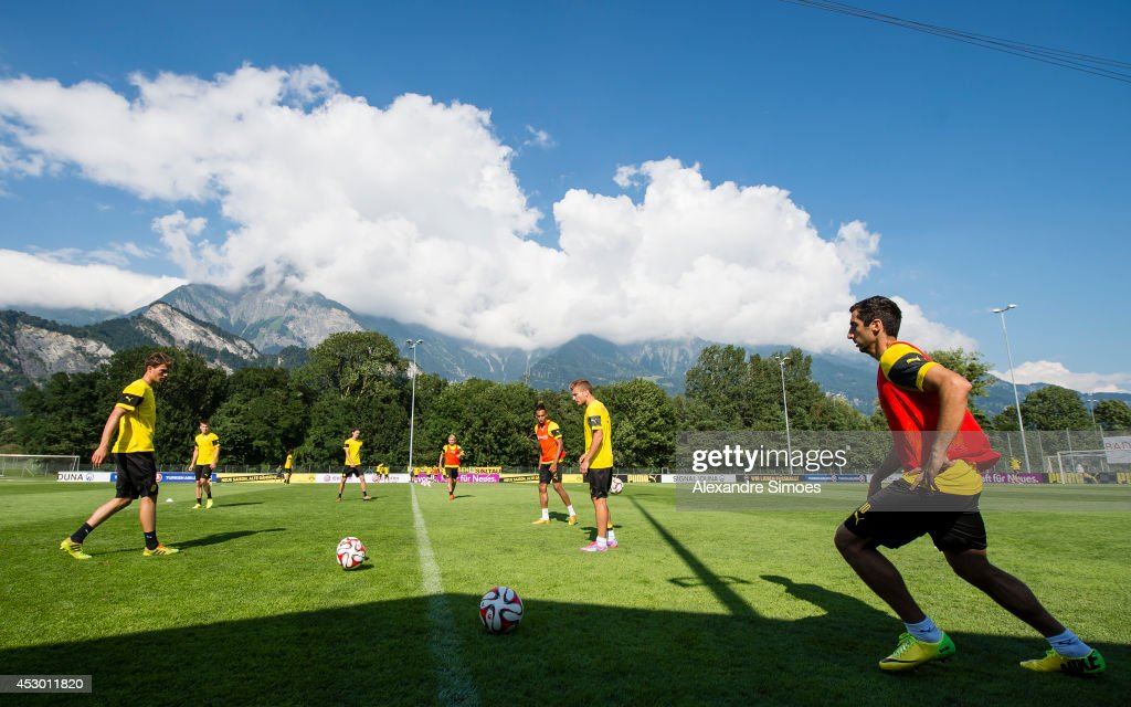 <a gi-track='captionPersonalityLinkClicked' href=/galleries/search?phrase=Henrikh+Mkhitaryan&family=editorial&specificpeople=6234732 ng-click='$event.stopPropagation()'>Henrikh Mkhitaryan</a> (BVB) (R), of Borussia Dortmund during a training session in the Borussia Dortmund training camp on July 31, 2014 in Bad Ragaz, Switzerland.