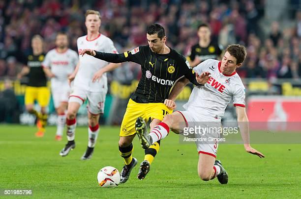 Henrikh Mkhitaryan of Borussia Dortmund gets challenged by Dominique Heintz of Kln during the Bundesliga match between 1 FC Koeln and Borussia...