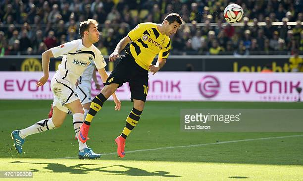 Henrikh Mkhitaryan of Borussia Dortmund heads his teams first goal during the Bundesliga match between Borussia Dortmund and SC Paderborn at Signal...