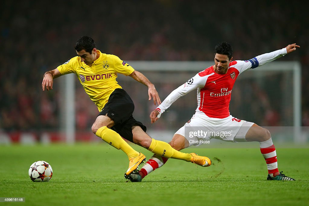 <a gi-track='captionPersonalityLinkClicked' href=/galleries/search?phrase=Henrikh+Mkhitaryan&family=editorial&specificpeople=6234732 ng-click='$event.stopPropagation()'>Henrikh Mkhitaryan</a> of Borussia Dortmund is brought down by <a gi-track='captionPersonalityLinkClicked' href=/galleries/search?phrase=Mikel+Arteta&family=editorial&specificpeople=235322 ng-click='$event.stopPropagation()'>Mikel Arteta</a> of Arsenal during the UEFA Champions League Group D match between Arsenal and Borussia Dortmund at the Emirates Stadium on November 26, 2014 in London, United Kingdom.