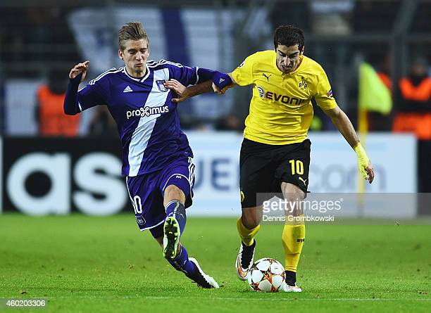 Henrikh Mkhitaryan of Borussia Dortmund is tackled by Dennis Praet of Anderlecht during the UEFA Champions League Group D match between Borussia...