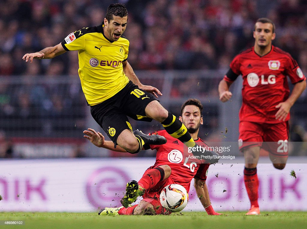 <a gi-track='captionPersonalityLinkClicked' href=/galleries/search?phrase=Henrikh+Mkhitaryan&family=editorial&specificpeople=6234732 ng-click='$event.stopPropagation()'>Henrikh Mkhitaryan</a> of Borussia Dortmund is tackled by Hakan Calhanoglu of Bayer Leverkusen during the Bundesliga match between Borussia Dortmund and Bayer Leverkusen at Signal Iduna Park on September 20, 2015 in Dortmund, Germany.