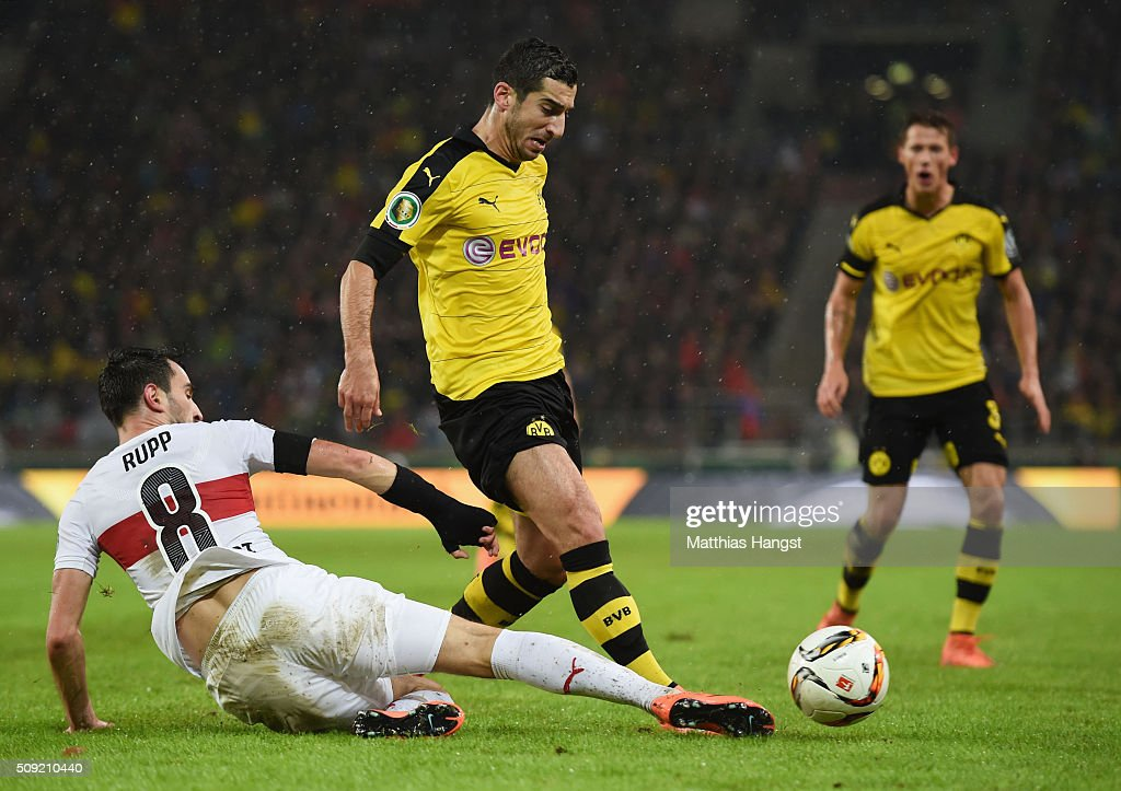 <a gi-track='captionPersonalityLinkClicked' href=/galleries/search?phrase=Henrikh+Mkhitaryan&family=editorial&specificpeople=6234732 ng-click='$event.stopPropagation()'>Henrikh Mkhitaryan</a> of Borussia Dortmund is tackled by Lukas Rupp of Stuttgart during the DFB Cup Quarter Final match between VfB Stuttgart and Borussia Dortmund at Mercedes-Benz Arena on February 9, 2016 in Stuttgart, Germany.