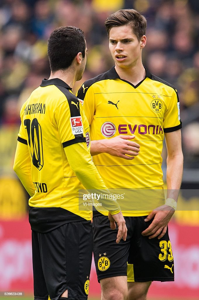 Henrikh Mkhitaryan of Borussia Dortmund, Julian Weigl of Borussia Dortmund during the Bundesliga match between Borussia Dortmund and VfL Wolfsburg on April 30, 2016 at the Signal Idun Park stadium in Dortmund, Germany.