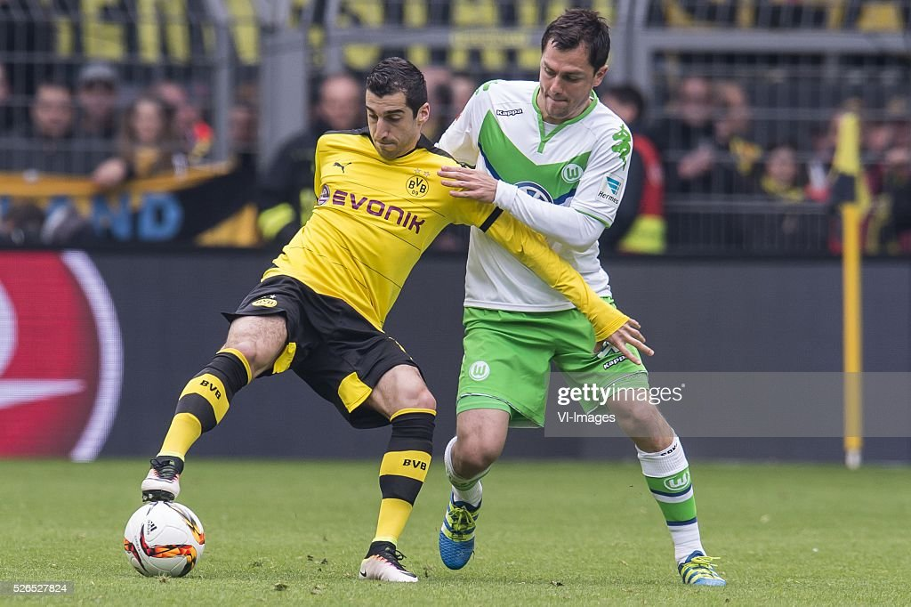Henrikh Mkhitaryan of Borussia Dortmund, Marcel Sch��fer of VFL Wolfsburg during the Bundesliga match between Borussia Dortmund and VfL Wolfsburg on April 30, 2016 at the Signal Idun Park stadium in Dortmund, Germany.
