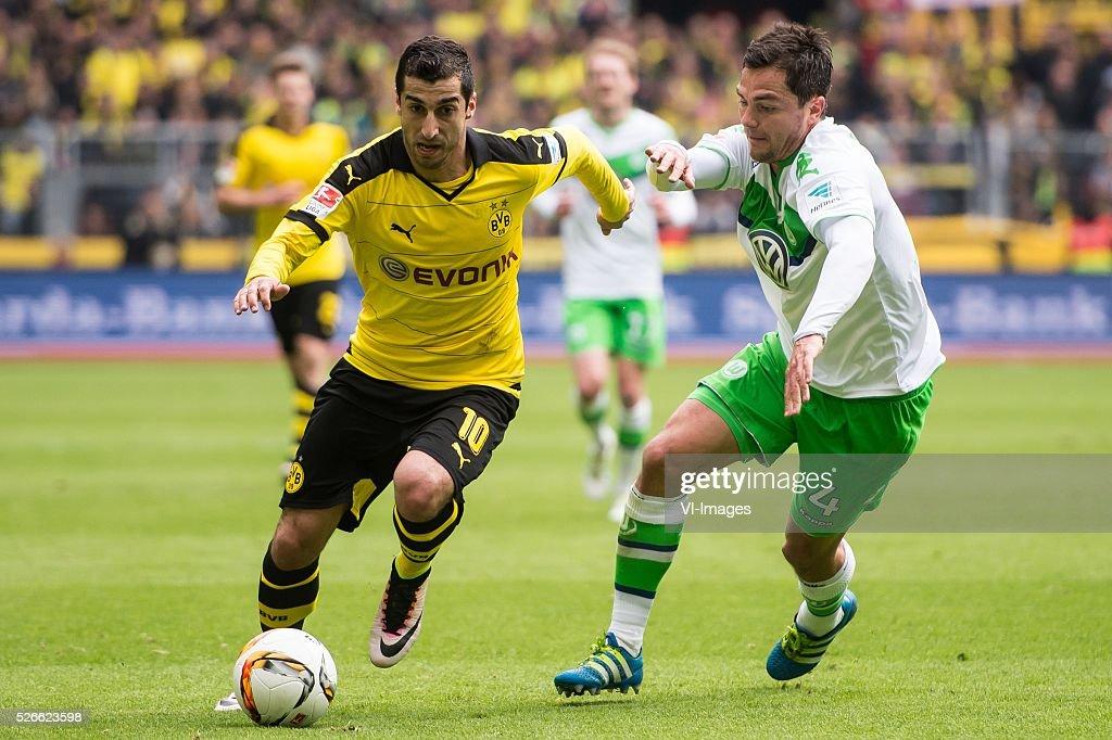 Henrikh Mkhitaryan of Borussia Dortmund, Marcel Sch��fer of VFL Wolfsburg during the Bundesliga match between Borussia Dortmund and VfL Wolfsburg on April 30, 2016 at the Signal Idun Park stadium in Dortmund, Germany.