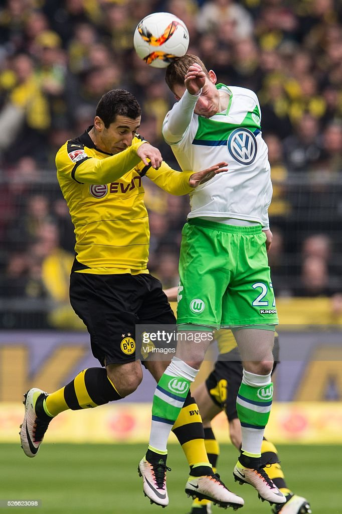 Henrikh Mkhitaryan of Borussia Dortmund, Maximilian Arnold of VFL Wolfsburg during the Bundesliga match between Borussia Dortmund and VfL Wolfsburg on April 30, 2016 at the Signal Idun Park stadium in Dortmund, Germany.