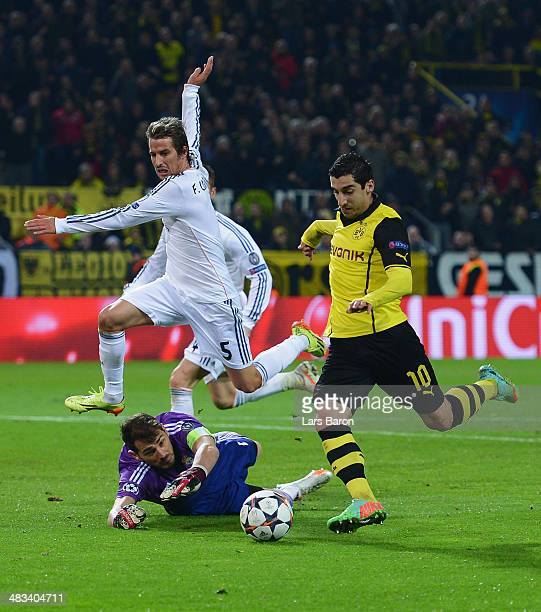 Henrikh Mkhitaryan of Borussia Dortmund misses a chance at goal as Iker Casillas and Fabio Coentrao of Real Madrid look on during the UEFA Champions...