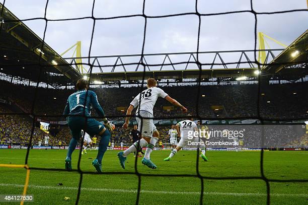 Henrikh Mkhitaryan of Borussia Dortmund scores the fourth goal during the Bundesliga match between Borussia Dortmund and Borussia Moenchengladbach at...