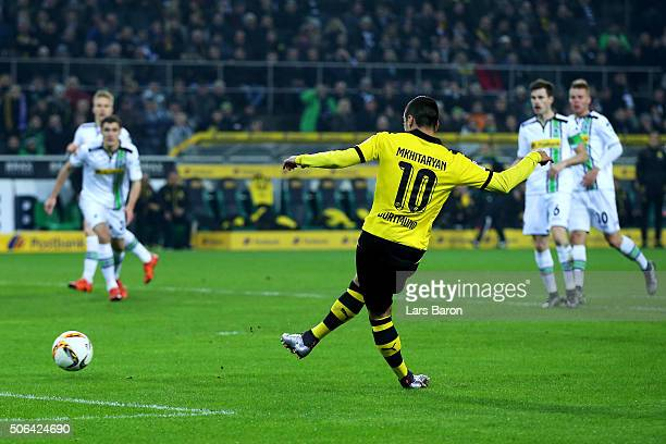 Henrikh Mkhitaryan of Borussia Dortmund scores their second goal during the Bundesliga match between Borussia Moenchengladbach and Borussia Dortmund...