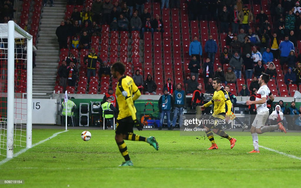 <a gi-track='captionPersonalityLinkClicked' href=/galleries/search?phrase=Henrikh+Mkhitaryan&family=editorial&specificpeople=6234732 ng-click='$event.stopPropagation()'>Henrikh Mkhitaryan</a> of Borussia Dortmund (2L) scores their third goal during the DFB Cup Quarter Final match between VfB Stuttgart and Borussia Dortmund at Mercedes-Benz Arena on February 9, 2016 in Stuttgart, Germany.