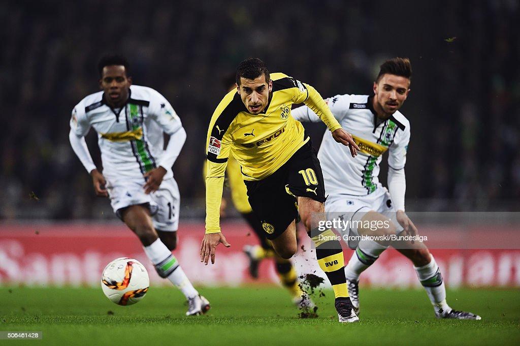 Henrikh Mkhitaryan of Borussia Dortmund vies for the ball chased by Julian Korb and Ibrahima Traore of Borussia Moenchengladbach during the Bundesliga match between Borussia Moenchengladbach and Borussia Dortmund at Borussia-Park on January 23, 2016 in Moenchengladbach, Germany.