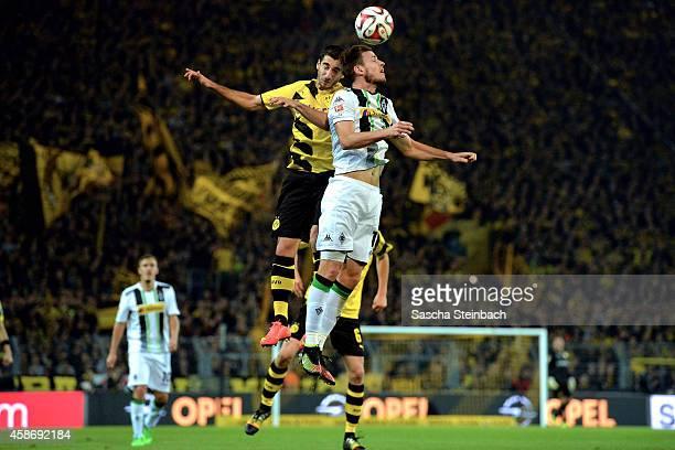 Henrikh Mkhitaryan of Dortmund and Harvard Nordveit of Moenchengladbach battle for a header during the Bundesliga match between Borussia Dortmund and...