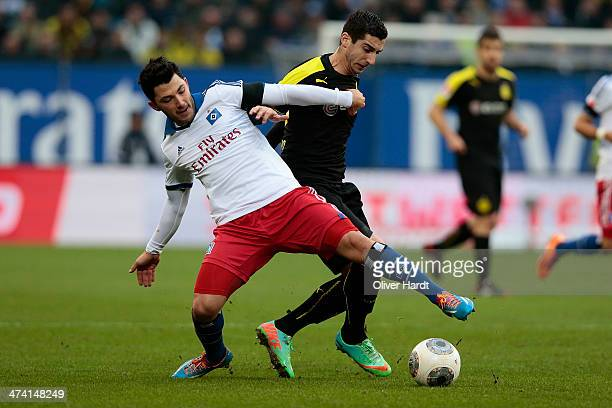 Henrikh Mkhitaryan of Dortmund and Tolgay Arslan of Hamburg compete for the ball during the Bundesliga match between Hamburger SV and Borussia...