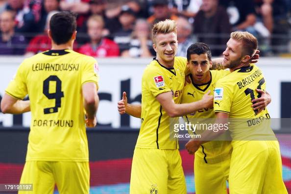 Henrikh Mkhitaryan of Dortmund celebrates his team's first goal with team mates Robert Lewandowski Marco Reus and Jakub Blaszczykowski during the...