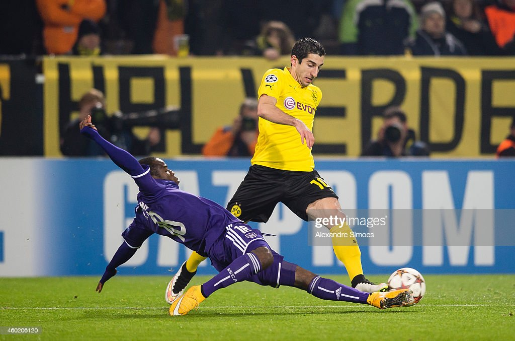 Henrikh Mkhitaryan of Dortmund challenges Frank Acheampong of Anderlecht during the UEFA Champions League first round in group D between RSC...