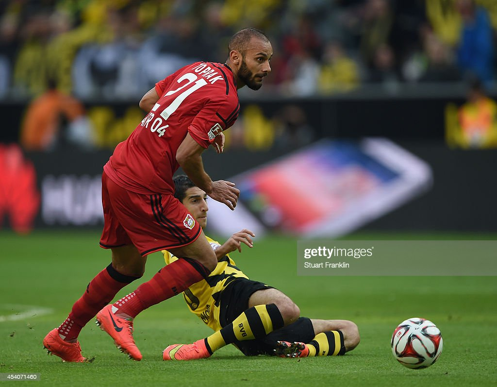 <a gi-track='captionPersonalityLinkClicked' href=/galleries/search?phrase=Henrikh+Mkhitaryan&family=editorial&specificpeople=6234732 ng-click='$event.stopPropagation()'>Henrikh Mkhitaryan</a> of Dortmund is challenged by <a gi-track='captionPersonalityLinkClicked' href=/galleries/search?phrase=Oemer+Toprak&family=editorial&specificpeople=5395932 ng-click='$event.stopPropagation()'>Oemer Toprak</a> of Leverkusen during the Bundesliga match between Borussia Dortmund and Bayer 04 Leverkusen at Signal Iduna Park on August 23, 2014 in Dortmund, Germany.