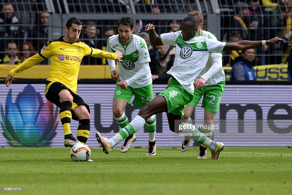 Henrikh Mkhitaryan of Dortmund vies with Josuha Guilavogui of Wolfsburg during the Bundesliga match between Borussia Dortmund and VfL Wolfsburg at Signal Iduna Park on April 29, 2016 in Dortmund, Germany.